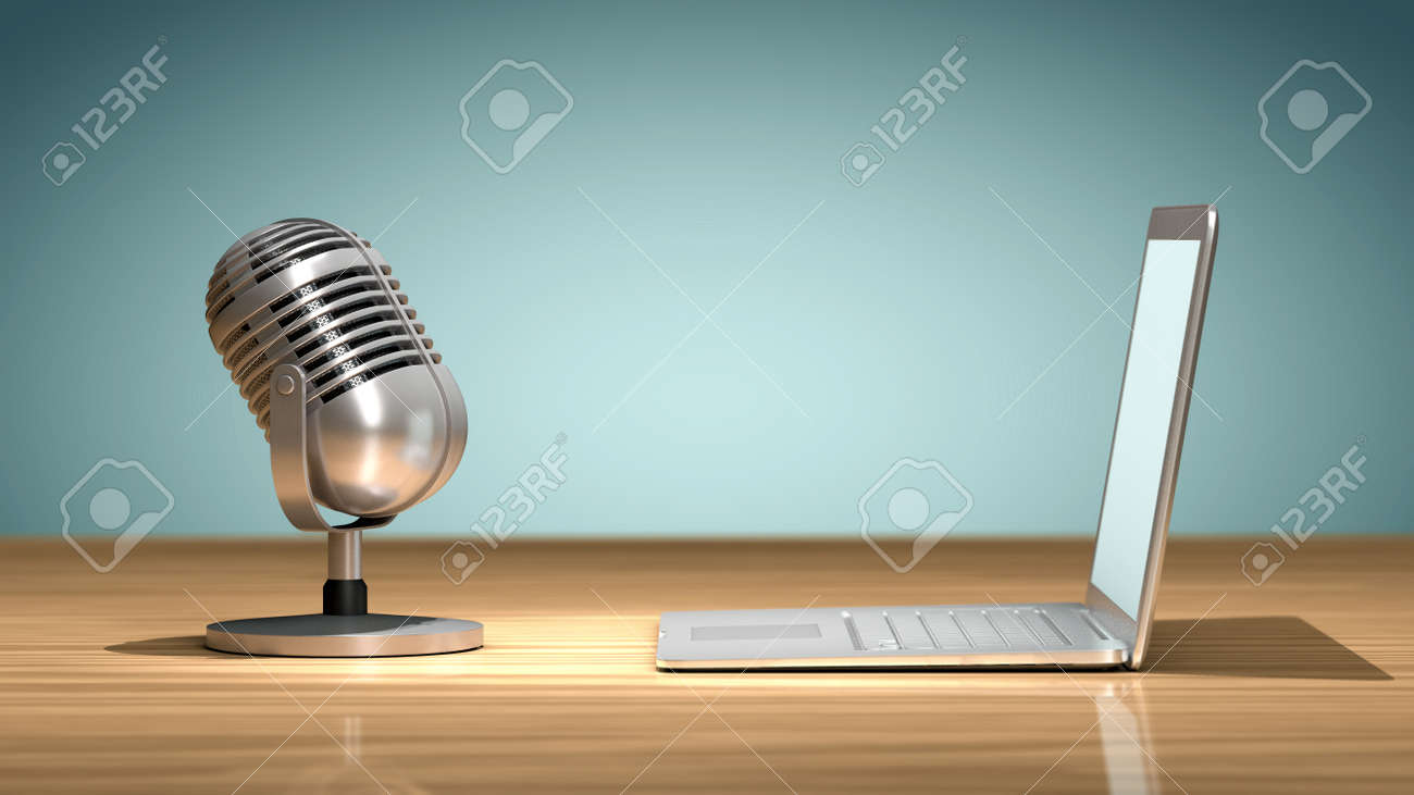 Vintage microphone in front of a laptop on a wooden table and oriented to record the sound. Concept of numerical recording or multimedia - 54657847