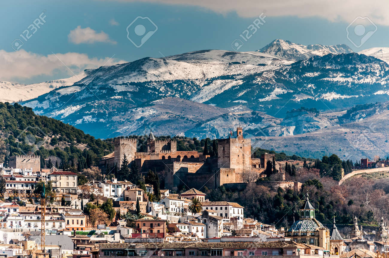 winter view of famous alhambra in front of sierra nevada mountains
