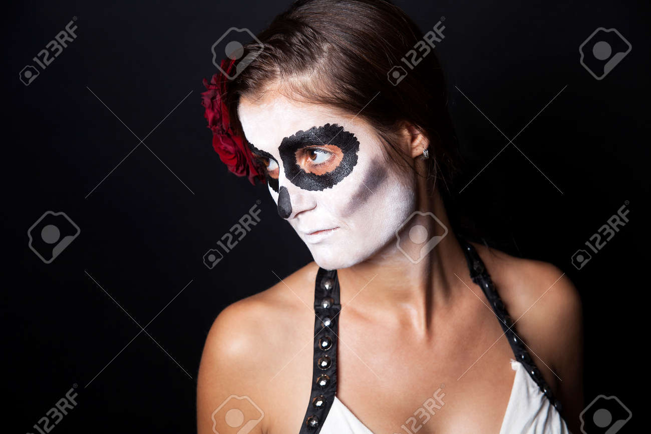 Stock Photo - Woman with makeup of la Santa Muerte with red rose in front of a black background & Woman With Makeup Of La Santa Muerte With Red Rose In Front Of ...