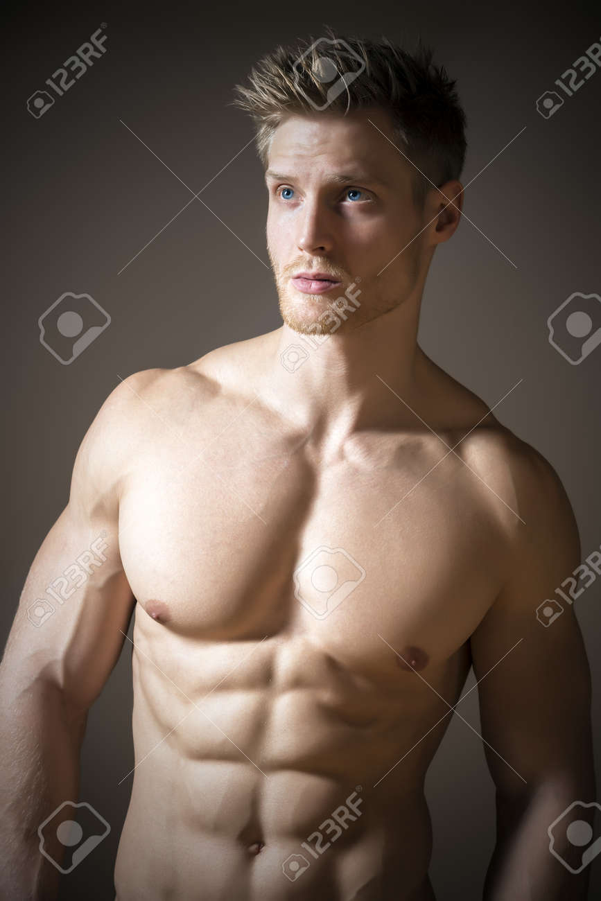 Blond Athletic Man With Blue Eyes And A Muscular Upper Body Stock