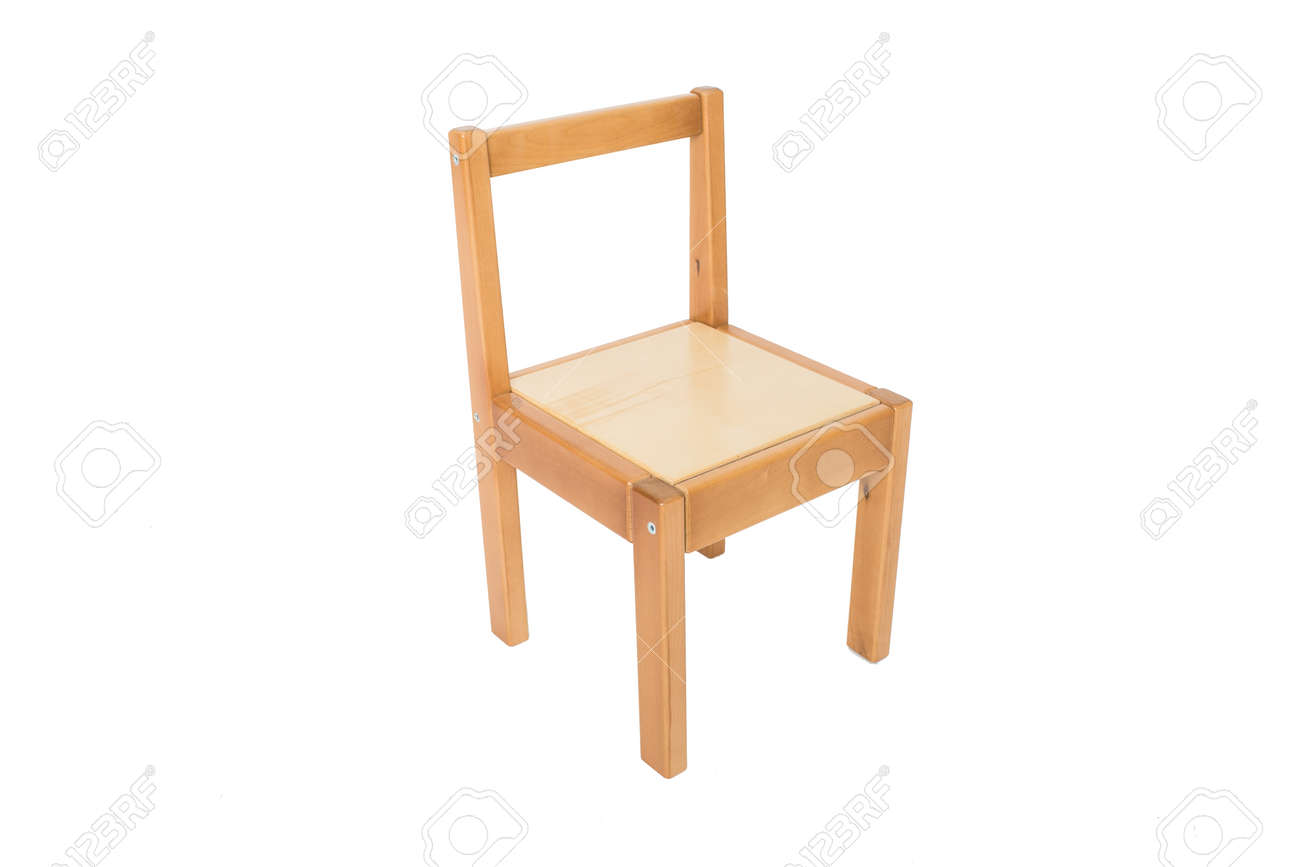 A traditional pine kitchen chair isolate on white - wooden furniture