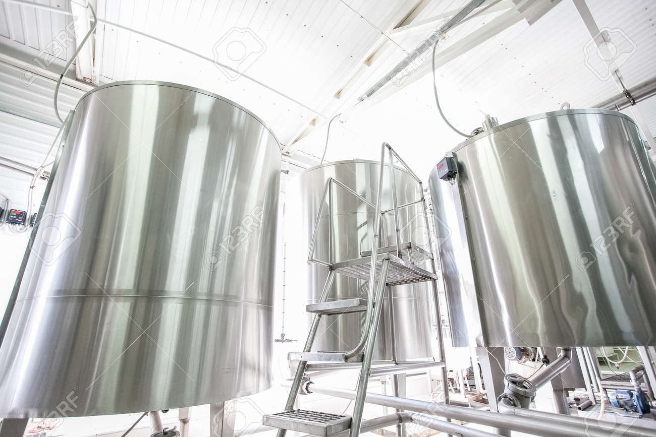 Steel new big vats on raw milk modern factory at sunny day - 54434964
