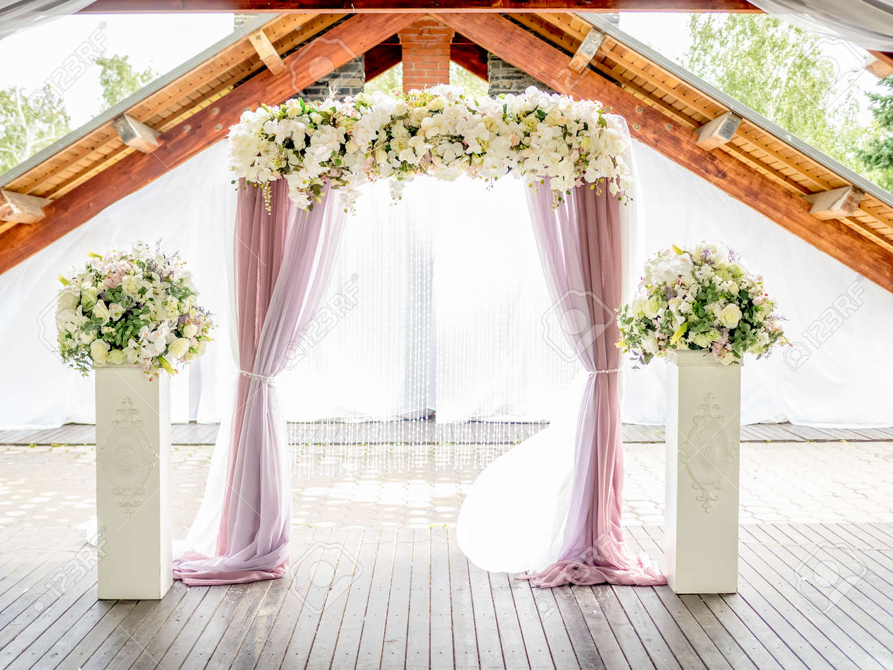floral wedding arch of white roses and lillies ith purple with curtains - 54805276