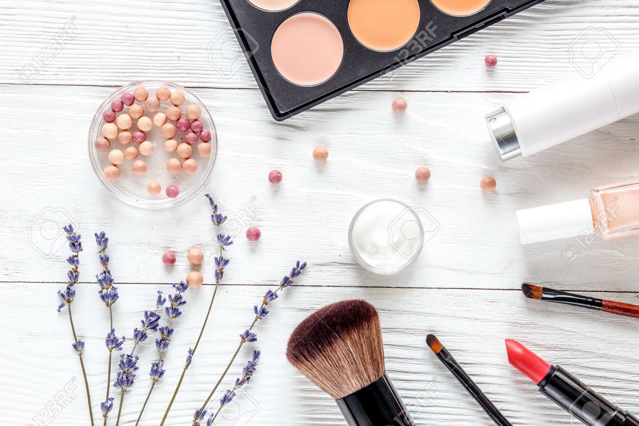 make up set on wooden table with lavender and glasses top view - 62054992