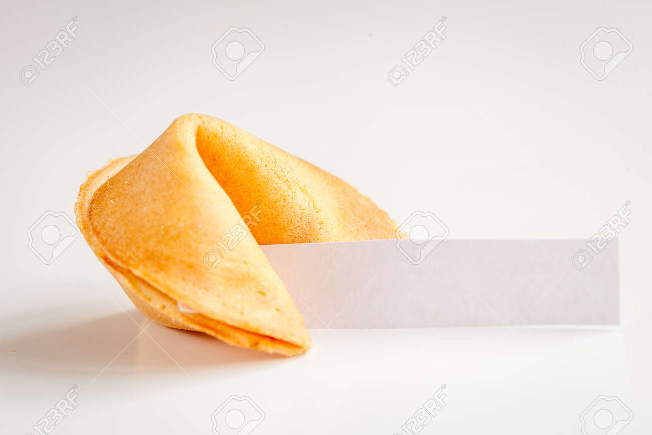 Chinese fortune cookie with prediction on white background close up - 67510905