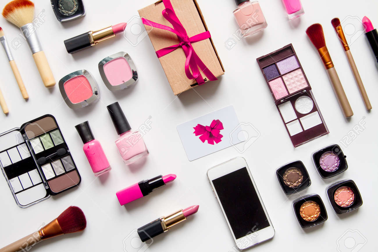 concept online shopping cosmetics on white background top view.