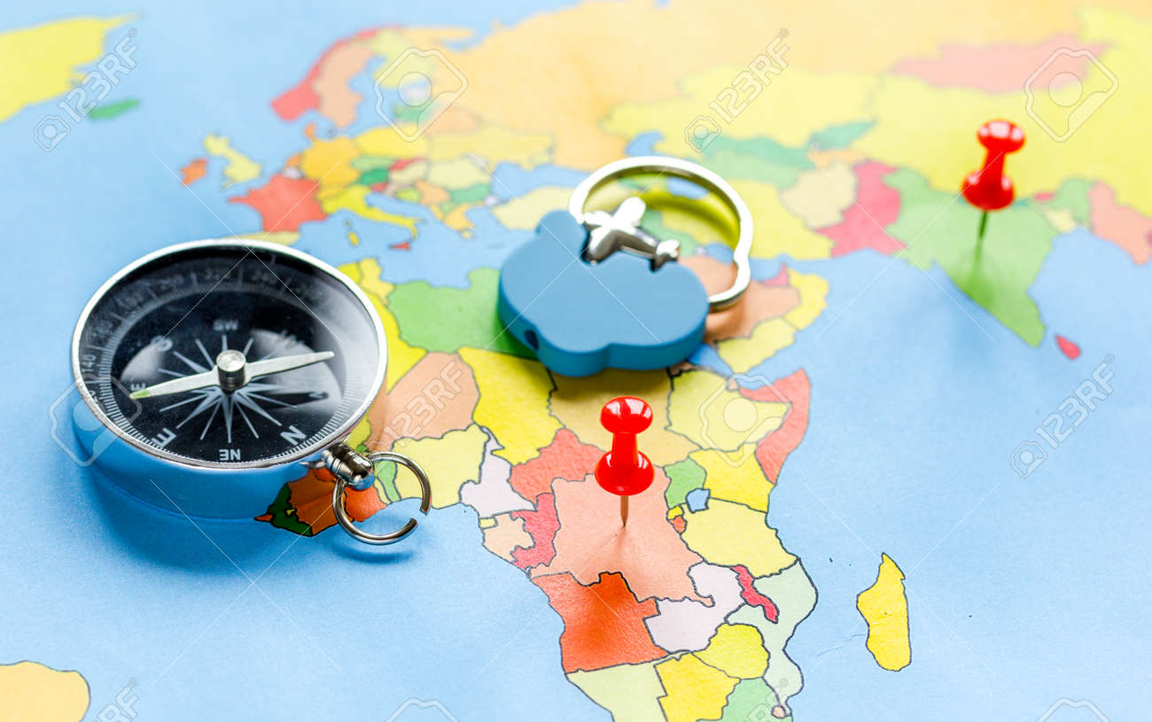 Map Of The World With Compass.Preparetion And Booking Travel Concept With Compass On Map Of