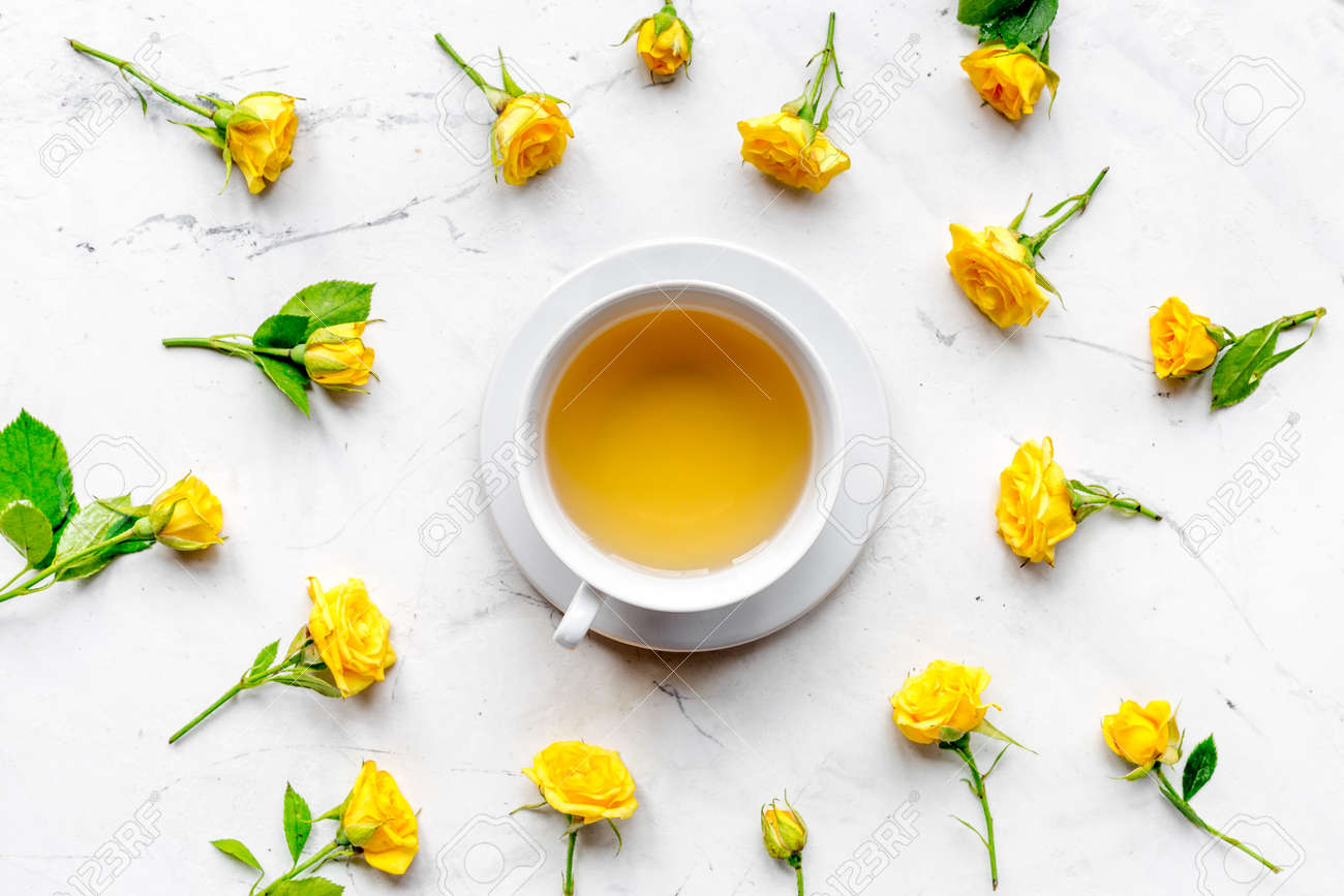 Spring flatlay with yellow flowers and cup tea on white marble spring flatlay with yellow flowers and cup tea on white marble table background top view stock mightylinksfo