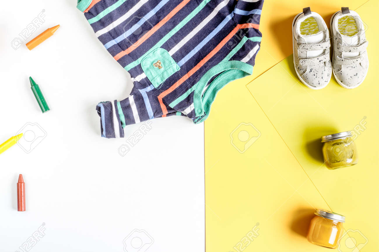 Kids Desk Design With Toys And Clothes On Yellow And White Background Stock Photo Picture And Royalty Free Image Image 76644894