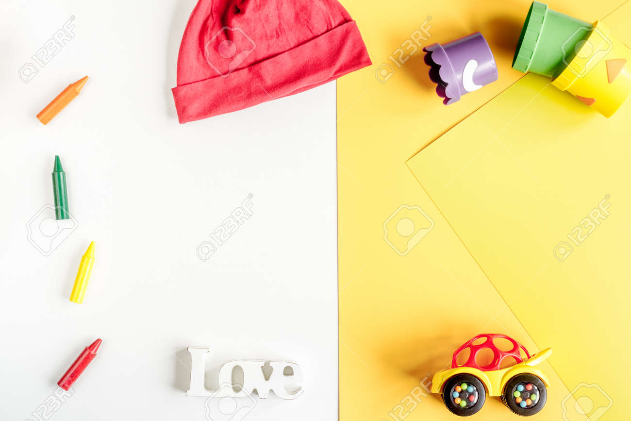 Kids Desk Design With Toys And Clothes Yellow White Background Stock Photo Picture And Royalty Free Image Image 81032123