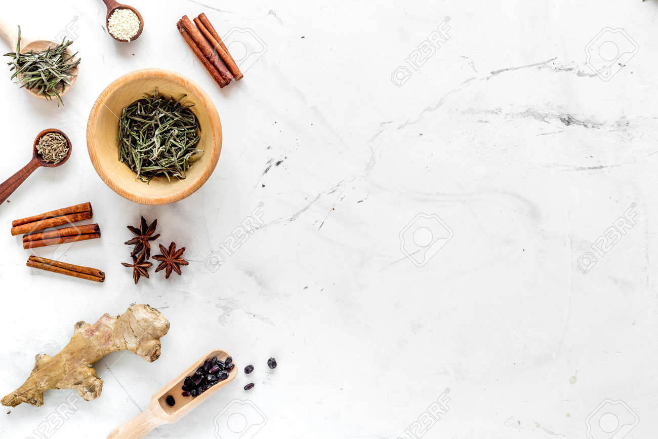 Spices, Cinnamon And Herbs On White Kitchen Table Background.. Stock Photo, Picture And Royalty Free Image. Image 81157339.
