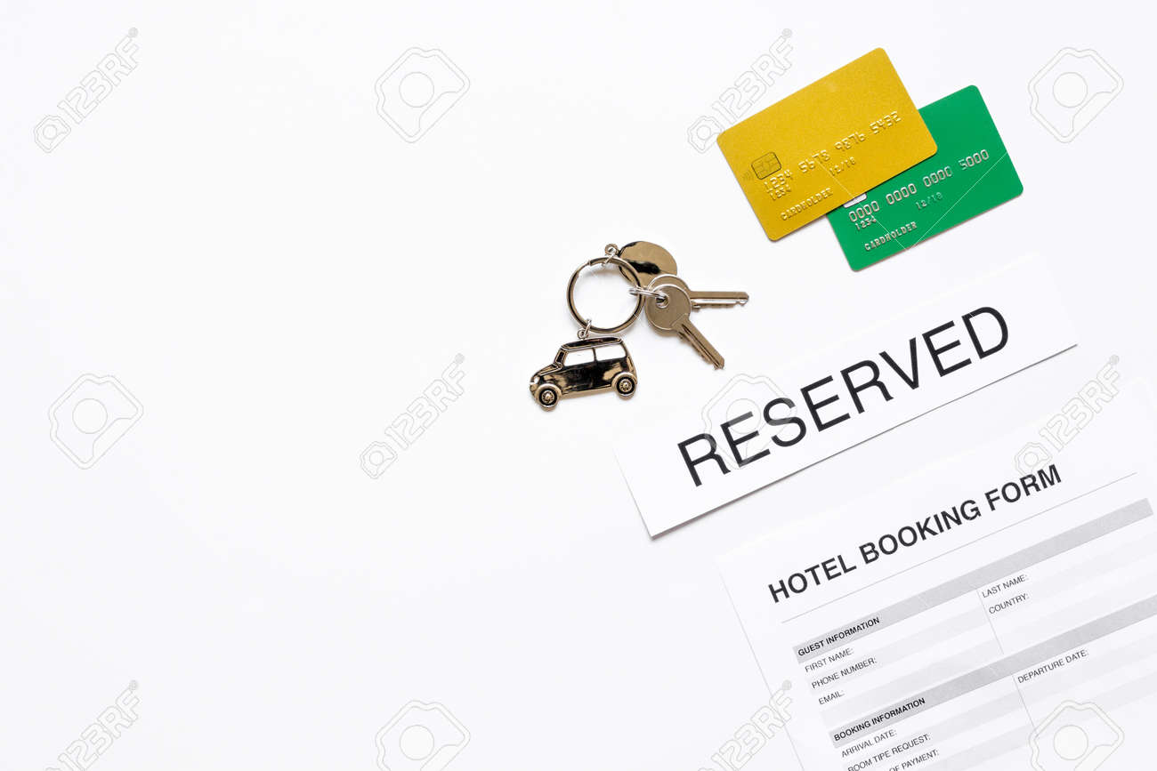 Booking form for hotel room reservation on white table background booking form for hotel room reservation on white table background top view space for text stock thecheapjerseys Choice Image