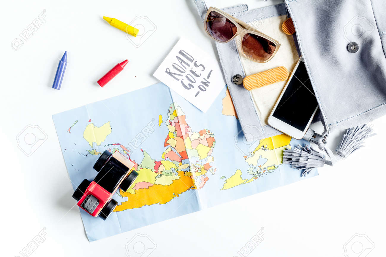 accessories for treveling with children and mobile phone on white table background top view - 82894122