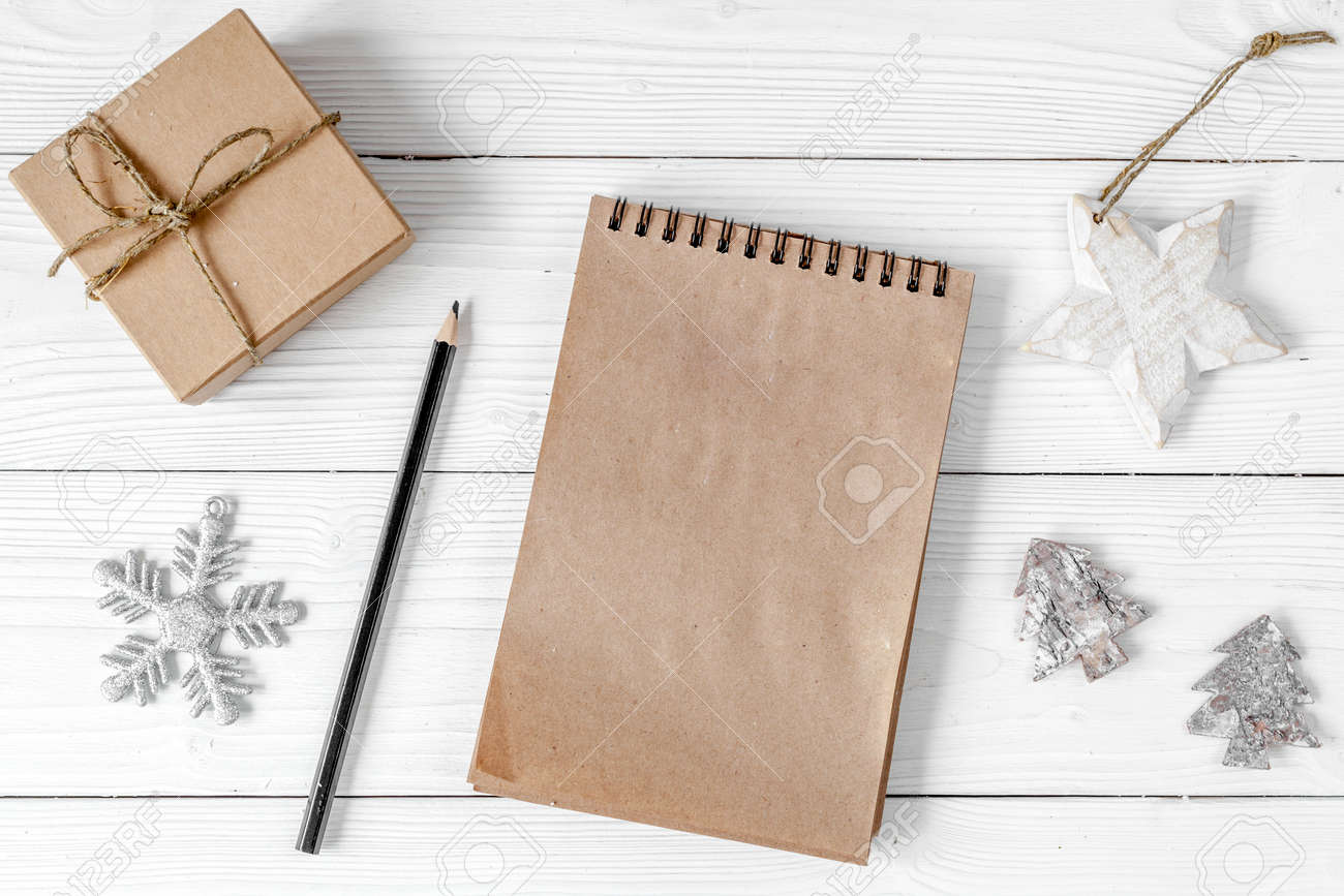 notebook and goals for new year wooden background top view - 85580761