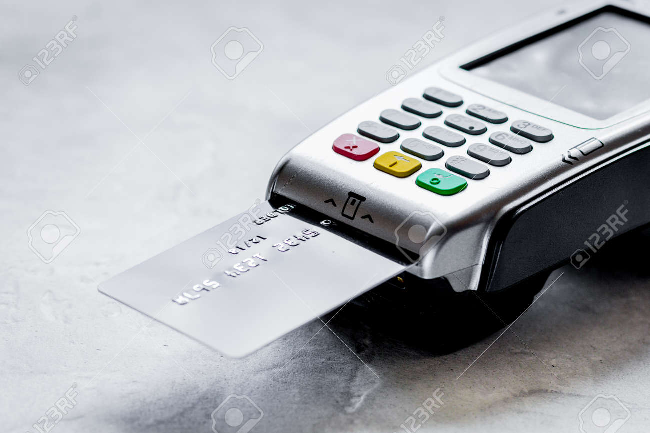 purchasing concept with card payment and terminal on table backg - 103054234