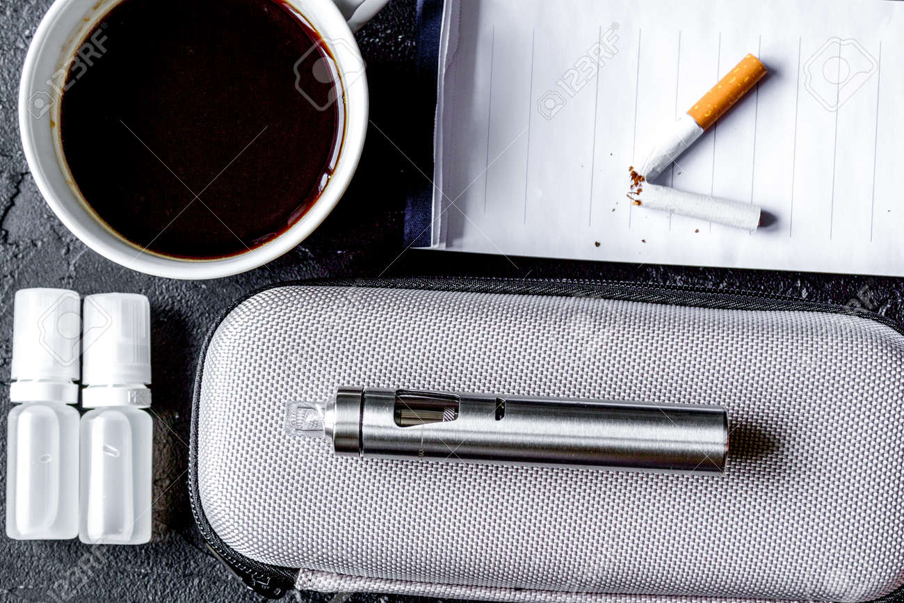 Concept of electronic cigarette on dark - 128805261