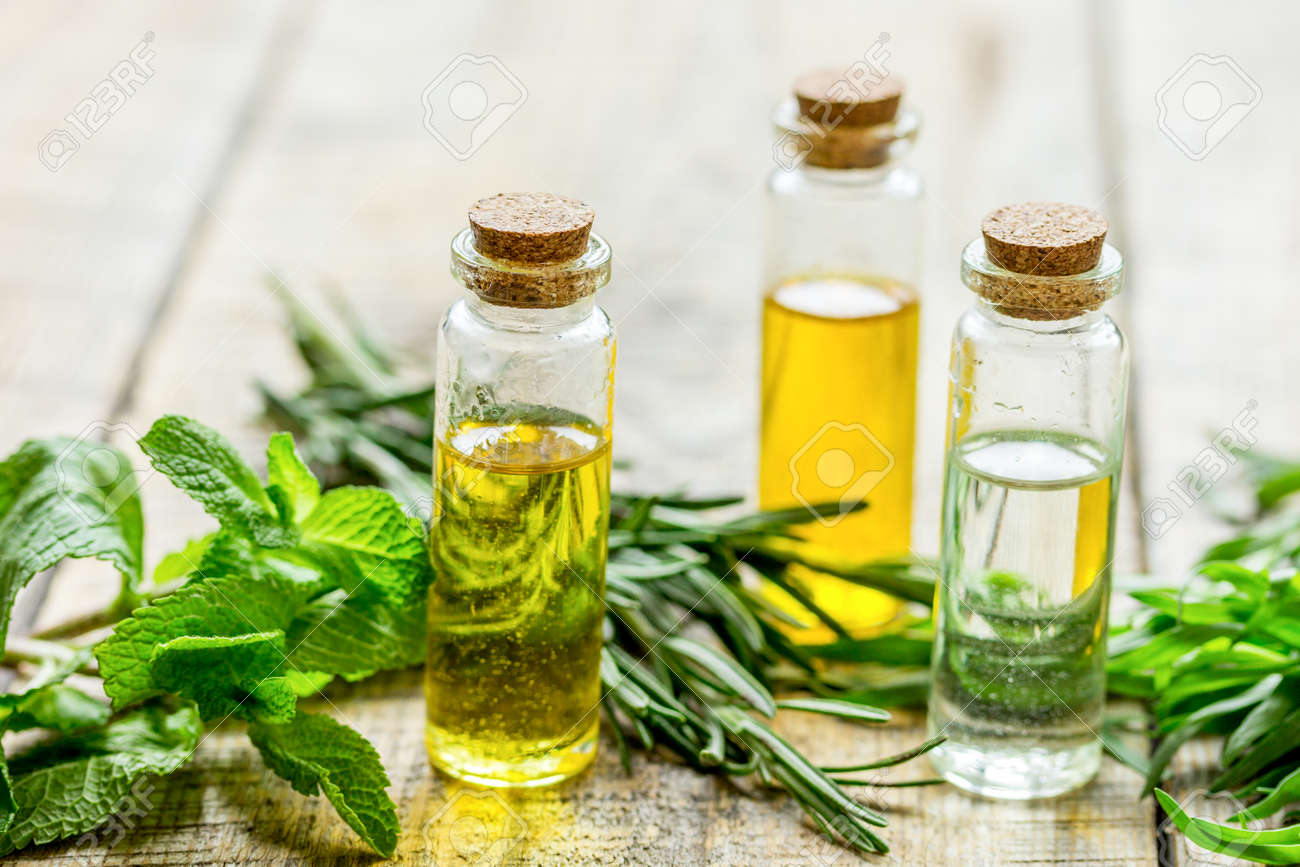 organic cosmetic oil in bottle with herbs on light wooden table background - 140163379