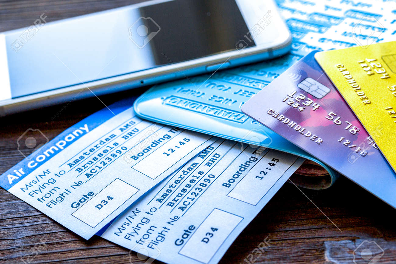 Buying airline tickets online with credit cards on table background - 165501472