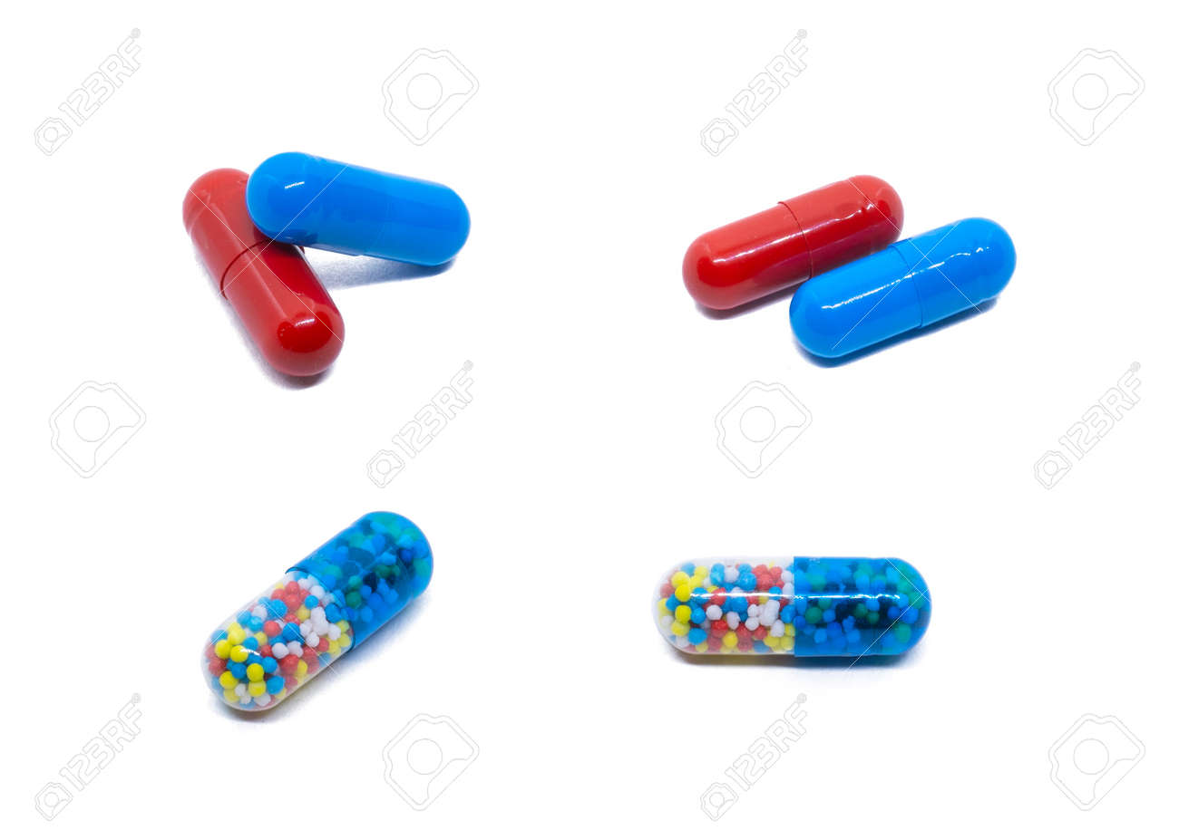 Pills isolated on white. Red and blue pills. Transparent tablet with colored particles. - 132225256