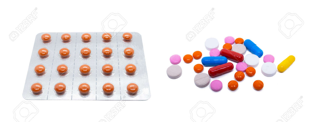 Orange pills in a plastic blister. A scattering of colored pills and medicines. Isolated pills on white - 132225337