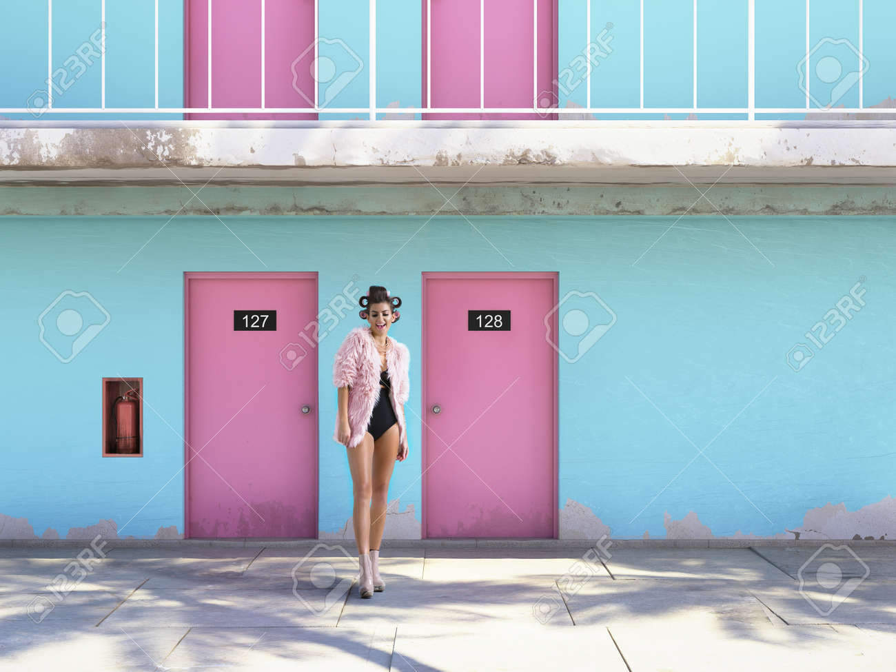 Woman Walking From Abandoned Motel With Pink Doors Vacation Stock Photo Picture And Royalty Free Image Image 69062954