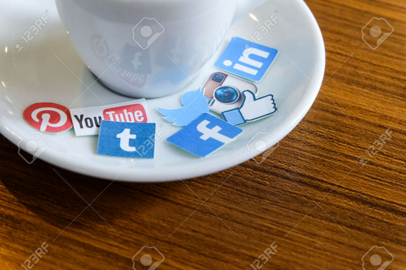 CHIANG MAI, THAILAND - SEPTEMBER 24, 2014: Social media brands printed on sticker and placed on hot coffee cup morning life. - 36939017