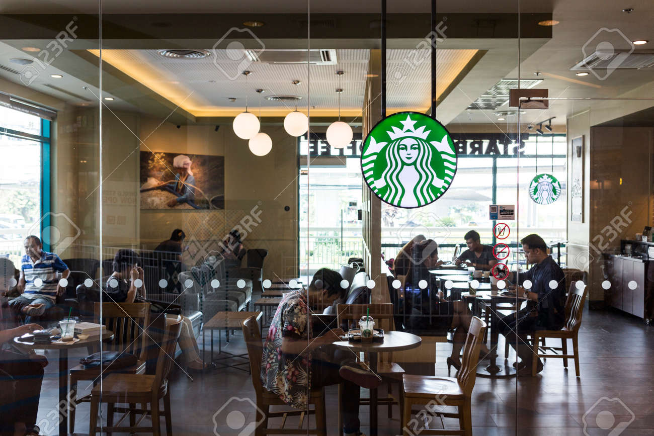 CHIANG MAI, THAILAND - OCTOBER 02, 2014: Starbucks coffee cafe at Chiang Mai Central Airport department store branch. - 36939684