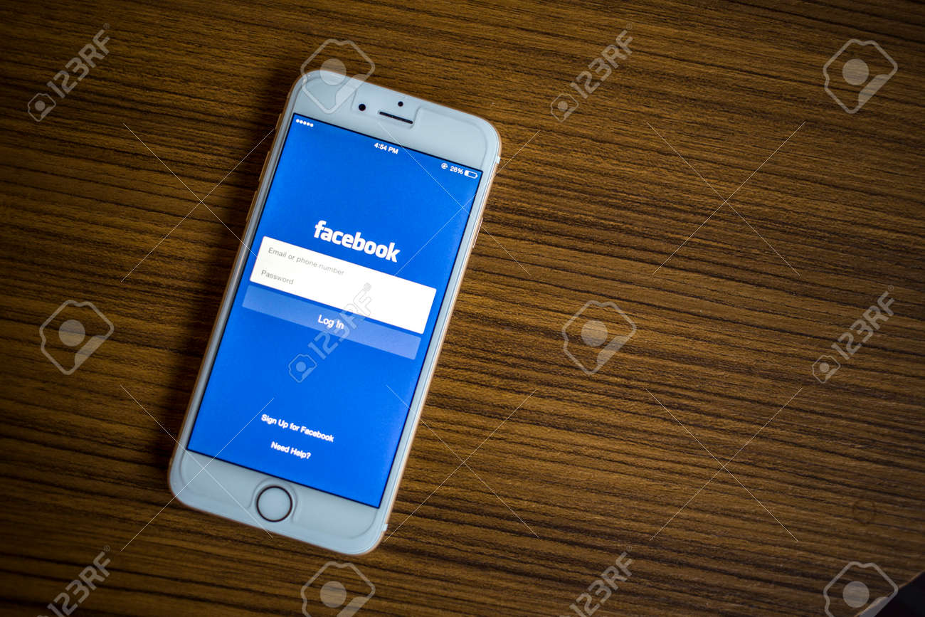 CHIANG MAI, THAILAND - JANUARY 02, 2015: Facebook Login page application using Apple iPhone 6. Facebook is largest and most popular social networking site in the world. - 37020012