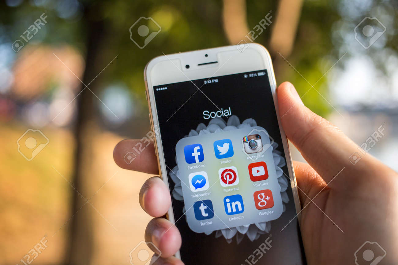 CHIANG MAI, THAILAND - JANUARY 04, 2015: All of popular social media icons on smartphone device screen with hand holding on Apple iPhone 6. - 37020226