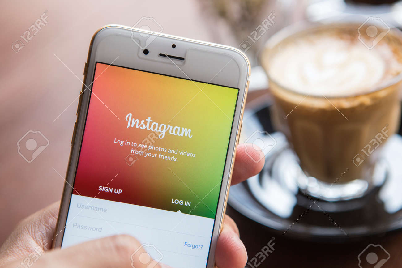 CHIANG MAI, THAILAND - APRIL 22, 2015: A man trying to log in Instagram application using Apple iPhone 6. Instagram is largest and most popular photograph social networking site in the world. - 42011767