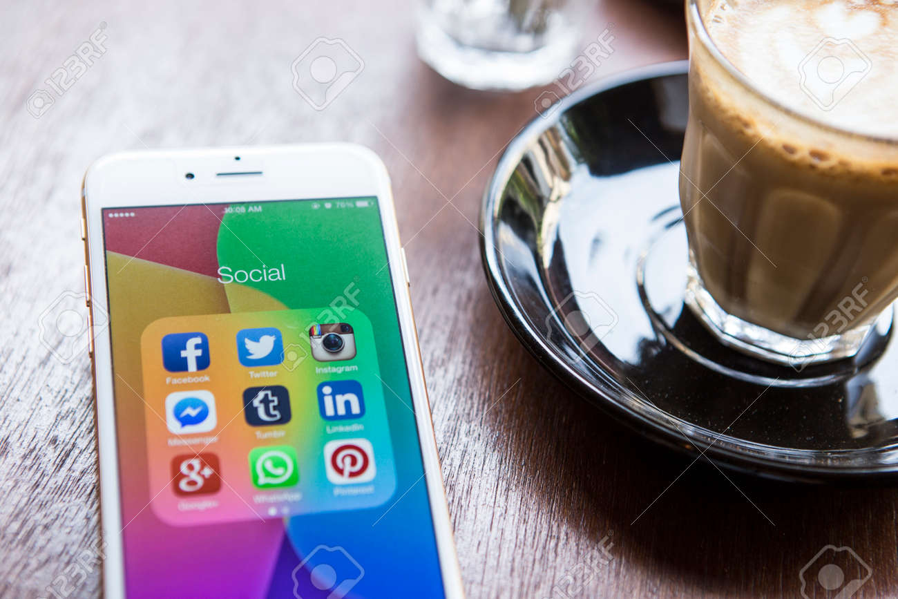 CHIANG MAI, THAILAND - APRIL 22, 2015: All of popular social media icons on smartphone device screen Apple iPhone 6 on coffee table. - 42011799