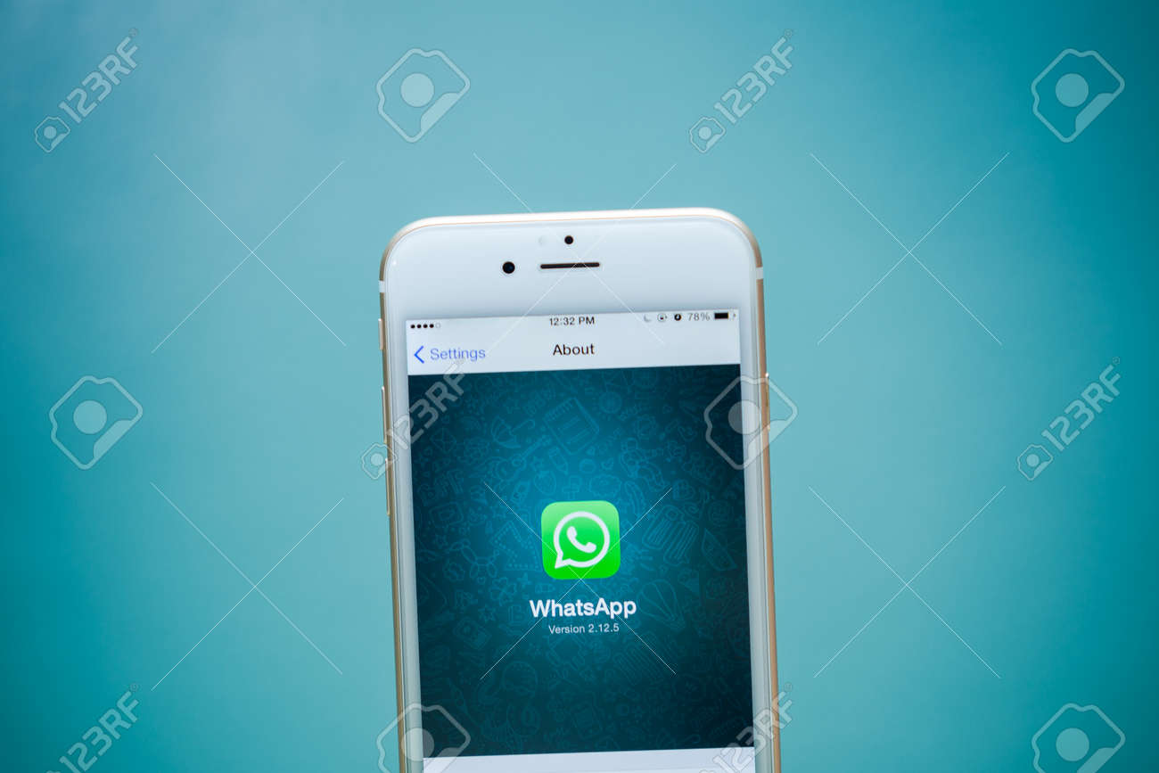 CHIANG MAI, THAILAND - SEPTEMBER 02, 2015: iPhone 6 with social Internet service WhatsApp screen on blue background. iPhone 6 was created and developed by the Apple inc. - 51715387