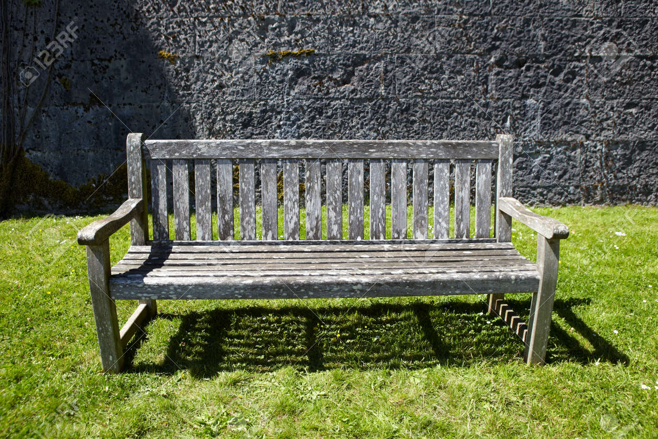 Brilliant Vintage Wooden Garden Bench Against Stone Wall Caraccident5 Cool Chair Designs And Ideas Caraccident5Info