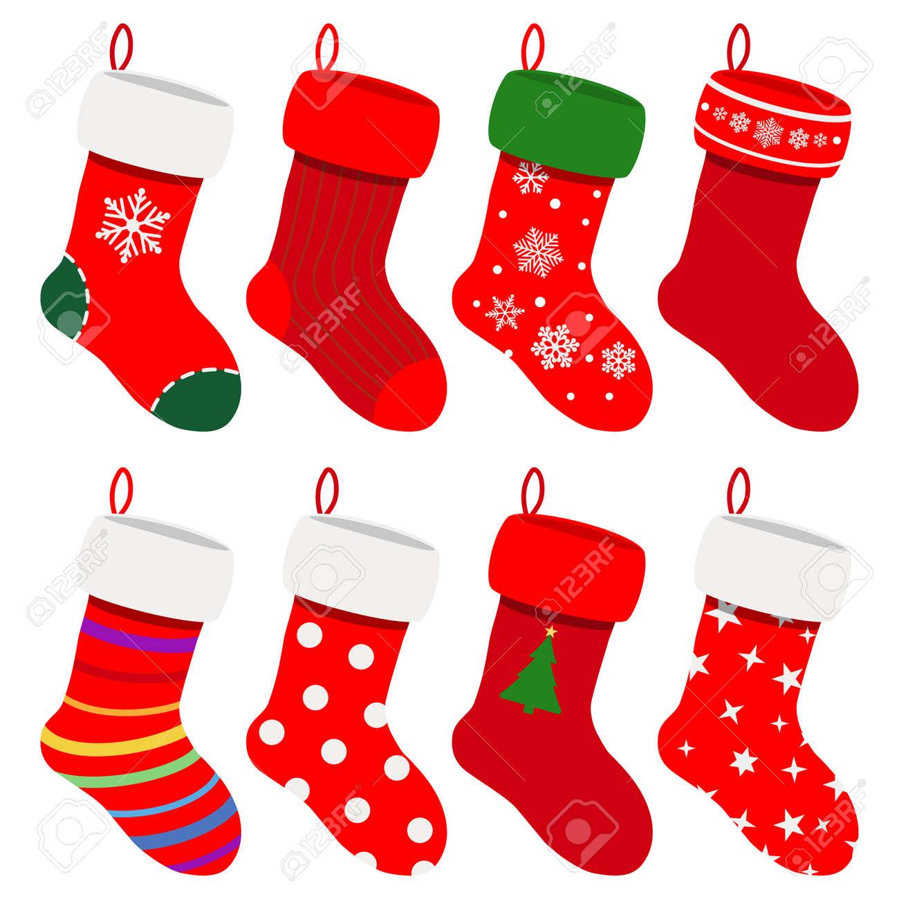 conjunto de calcetines de navidad en colores rojos con varios patrones foto de archivo