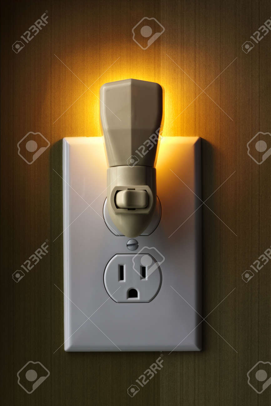 Closeup of lit nightlight plugged into wall outlet giving off closeup of lit nightlight plugged into wall outlet giving off warm glow stock photo 5523726 aloadofball Choice Image