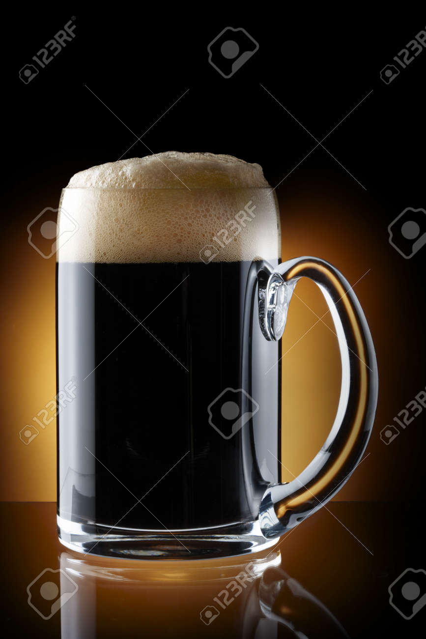 Close up shot of pint of dark beer shot on rich brown background with space for copy Stock Photo - 7244145