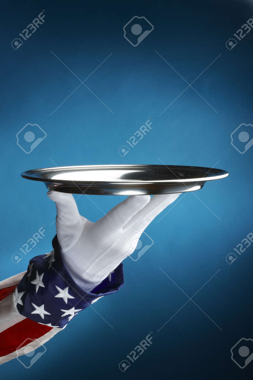 Close up shot of uncle sam holding empty silver tray with space for copy Stock Photo - 8571669