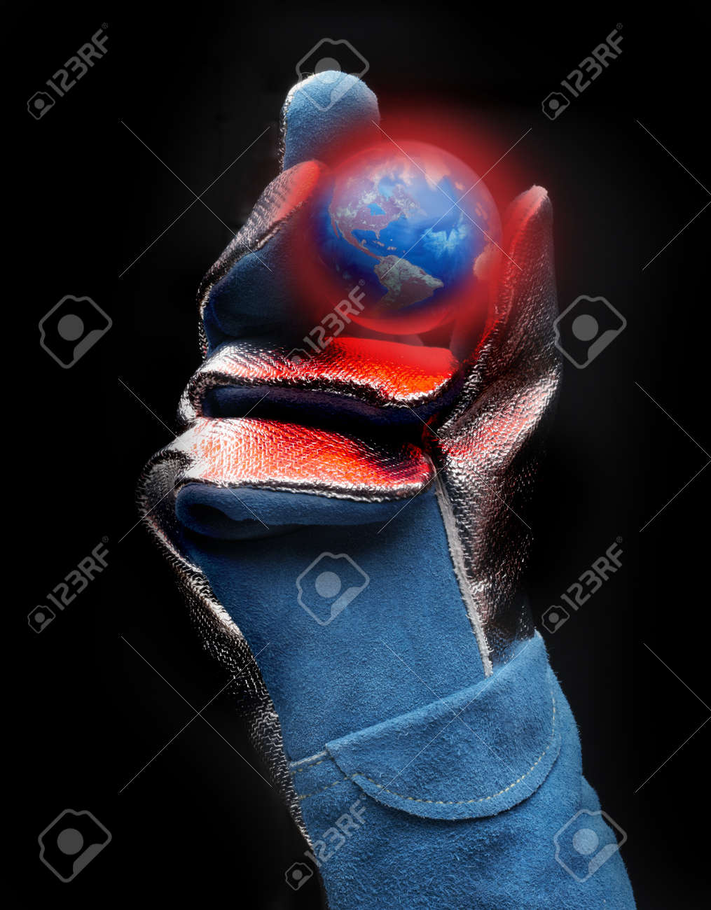 Asbestos gloved hand holds red hot model of earth with view of the Americas Stock Photo - 8651447