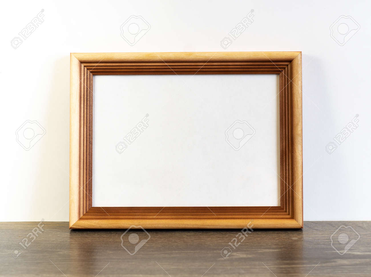 Frame mockup with horizontal wooden frame on white wall background - 136851255