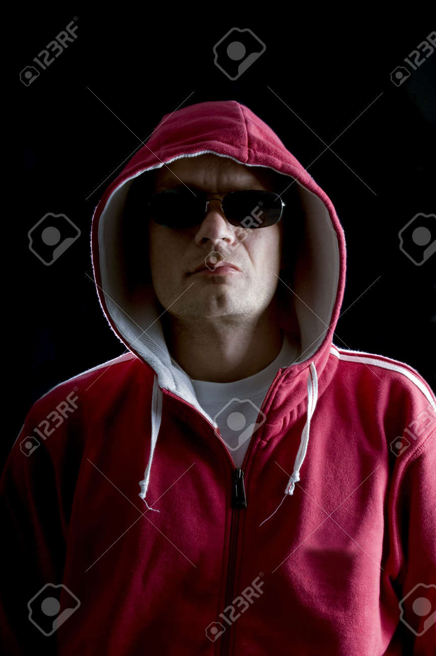 A grim looking Hoodlum wearing sunglasses, and looking mean Stock Photo - 2367861