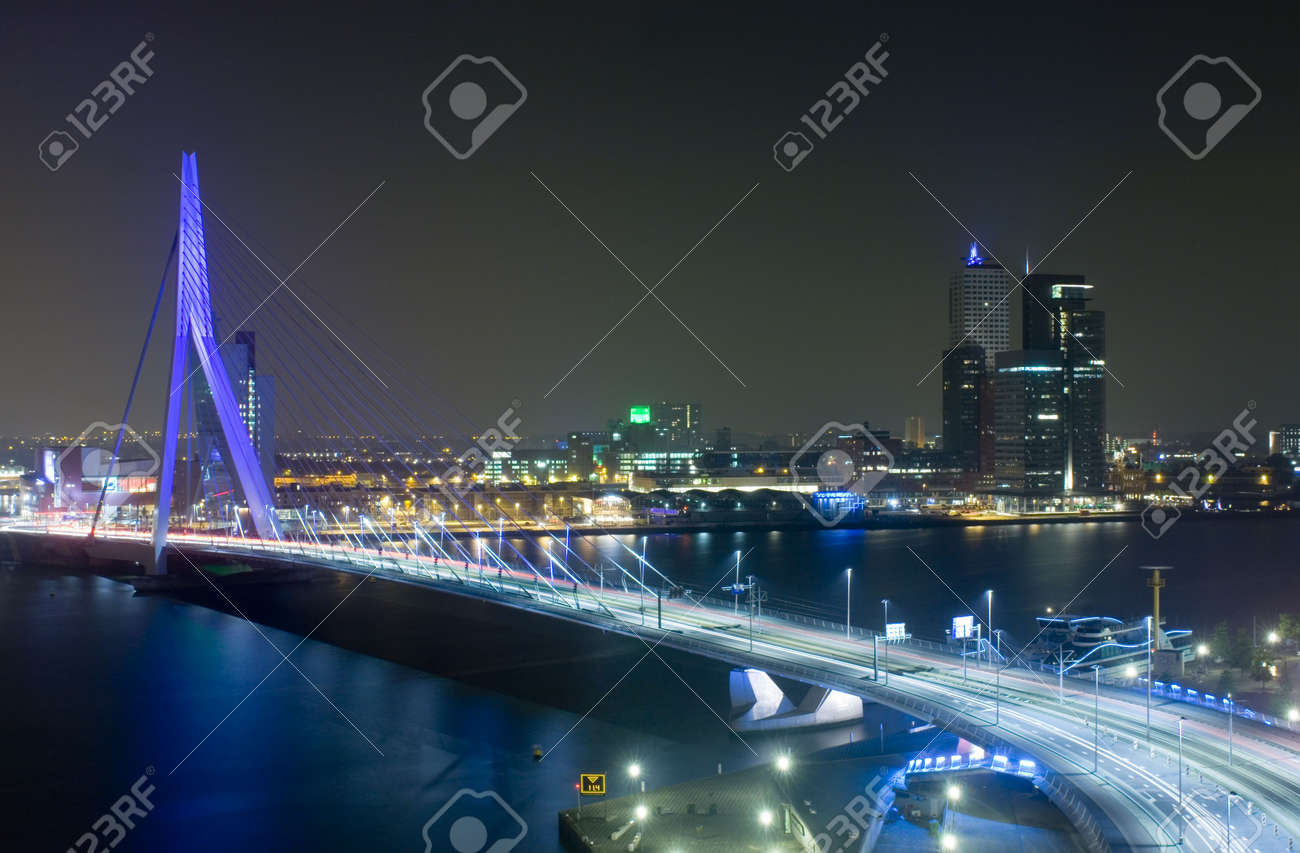The Rotterdam Skyline with the famous Erasmus Bridge over the river Meuze at night Stock Photo - 2557985