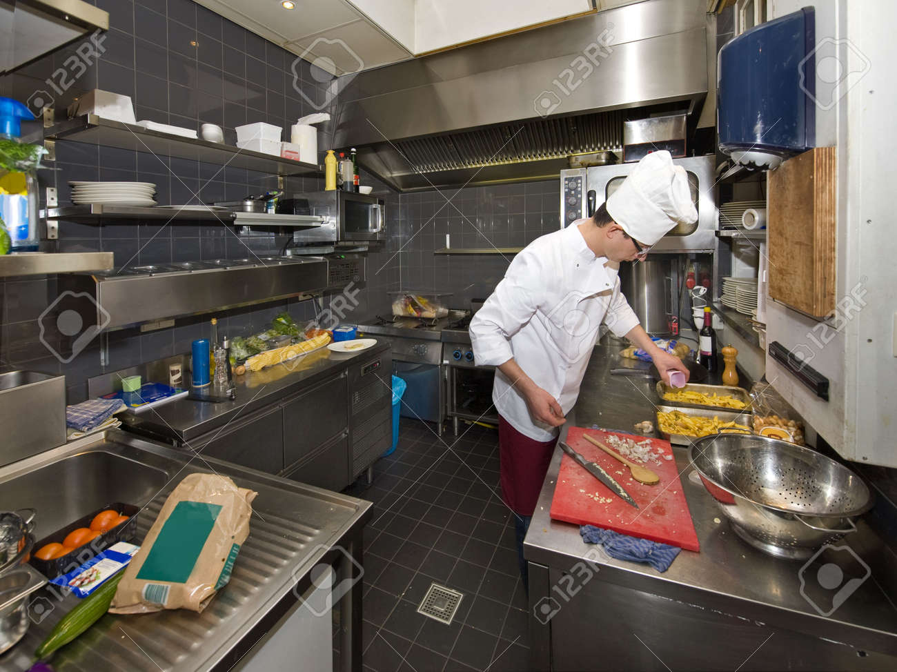 Chef Kitchen A Chef In A Profesional Kitchen Preparing Dinner Stock Photo