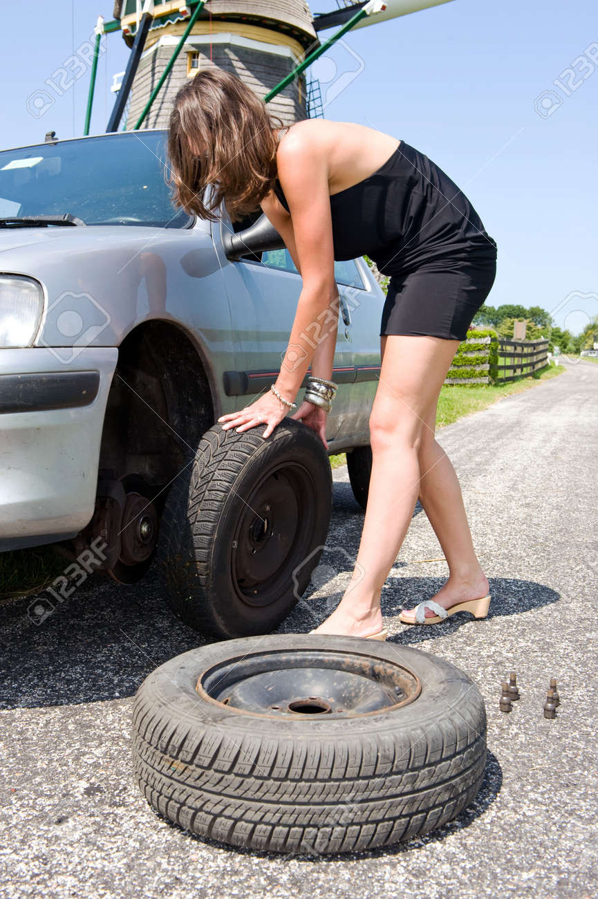 Image result for woman changing tire