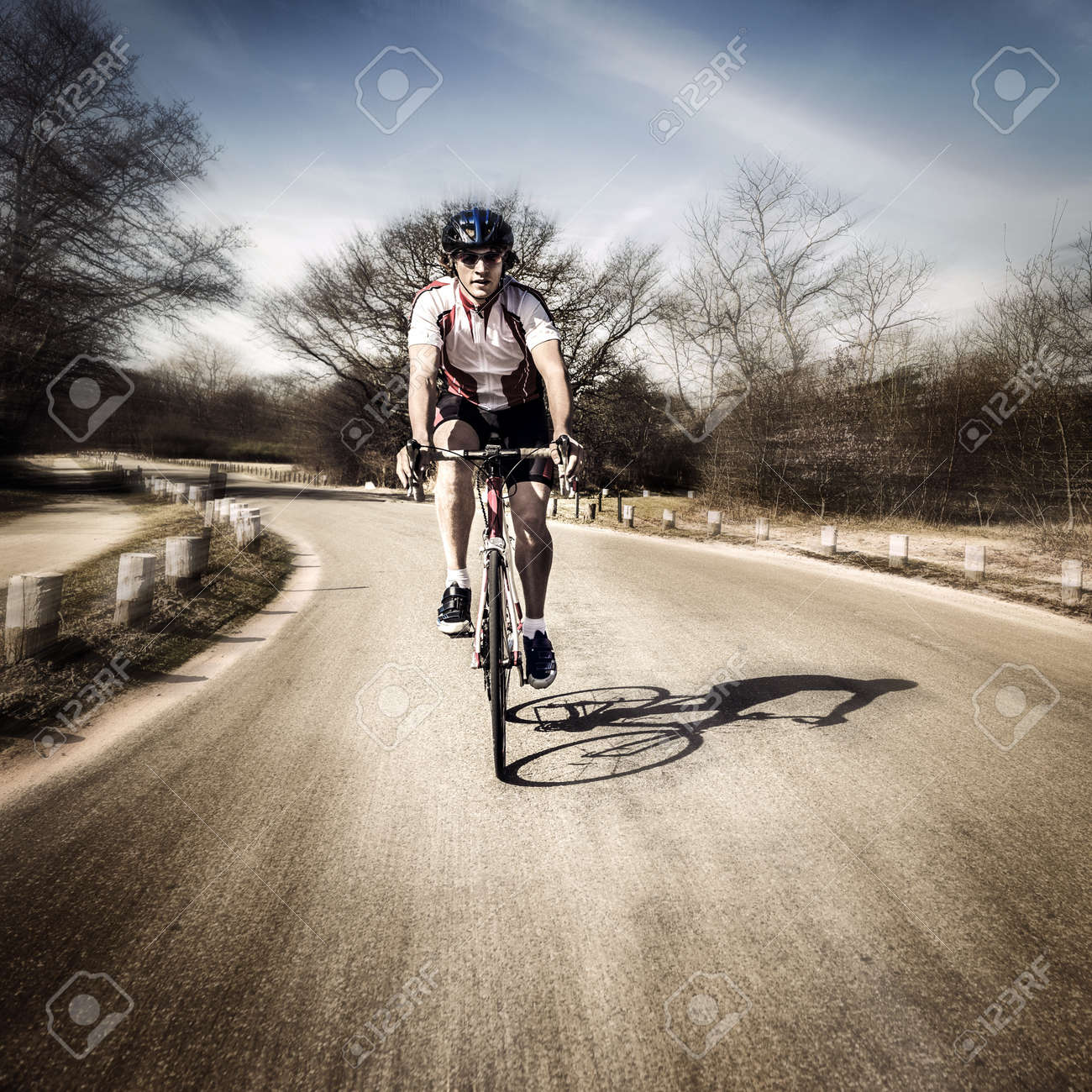 Two cyclists on the road touring at speed Stock Photo - 13646364