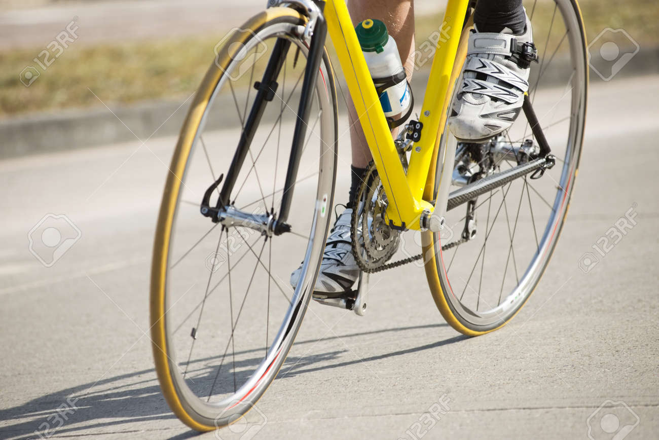 Low section of male athlete riding bicycle on a country road Stock Photo - 13929370