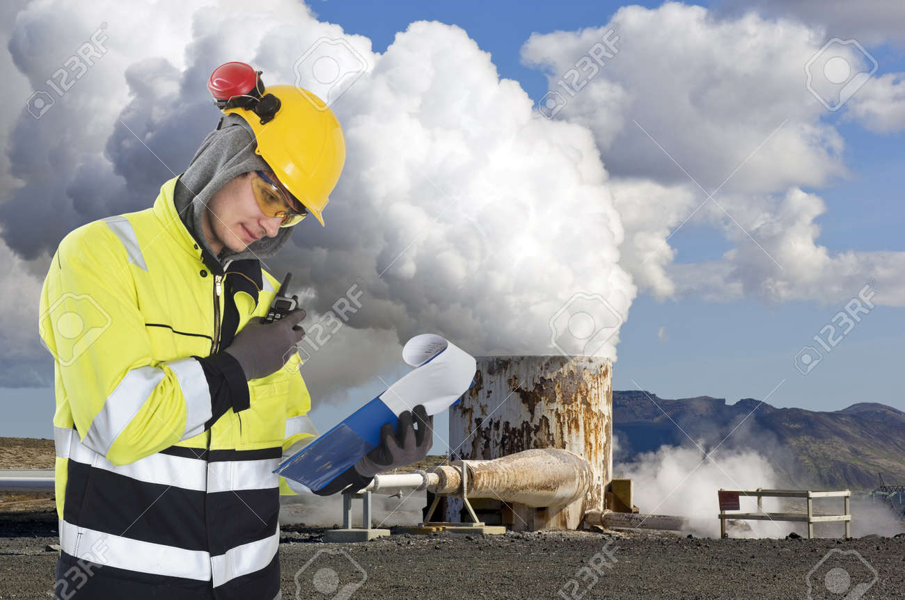 geothermal engineer and geologist reading data from a list at a gothermal power plant in iceland - Power Plant Engineer