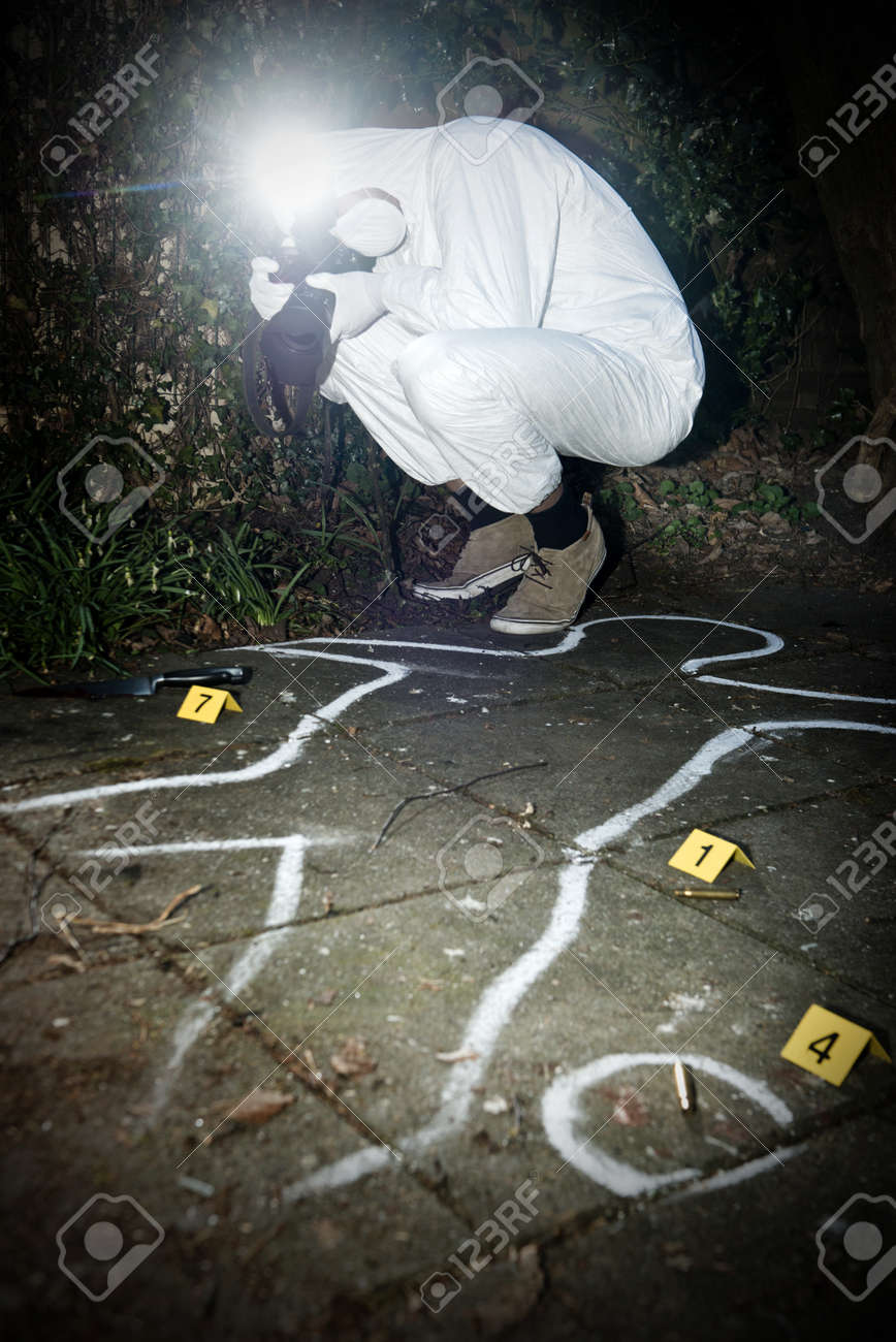 Crime Scene Photographer Taking A Photo Fo During The Forensics Research Of Murder In