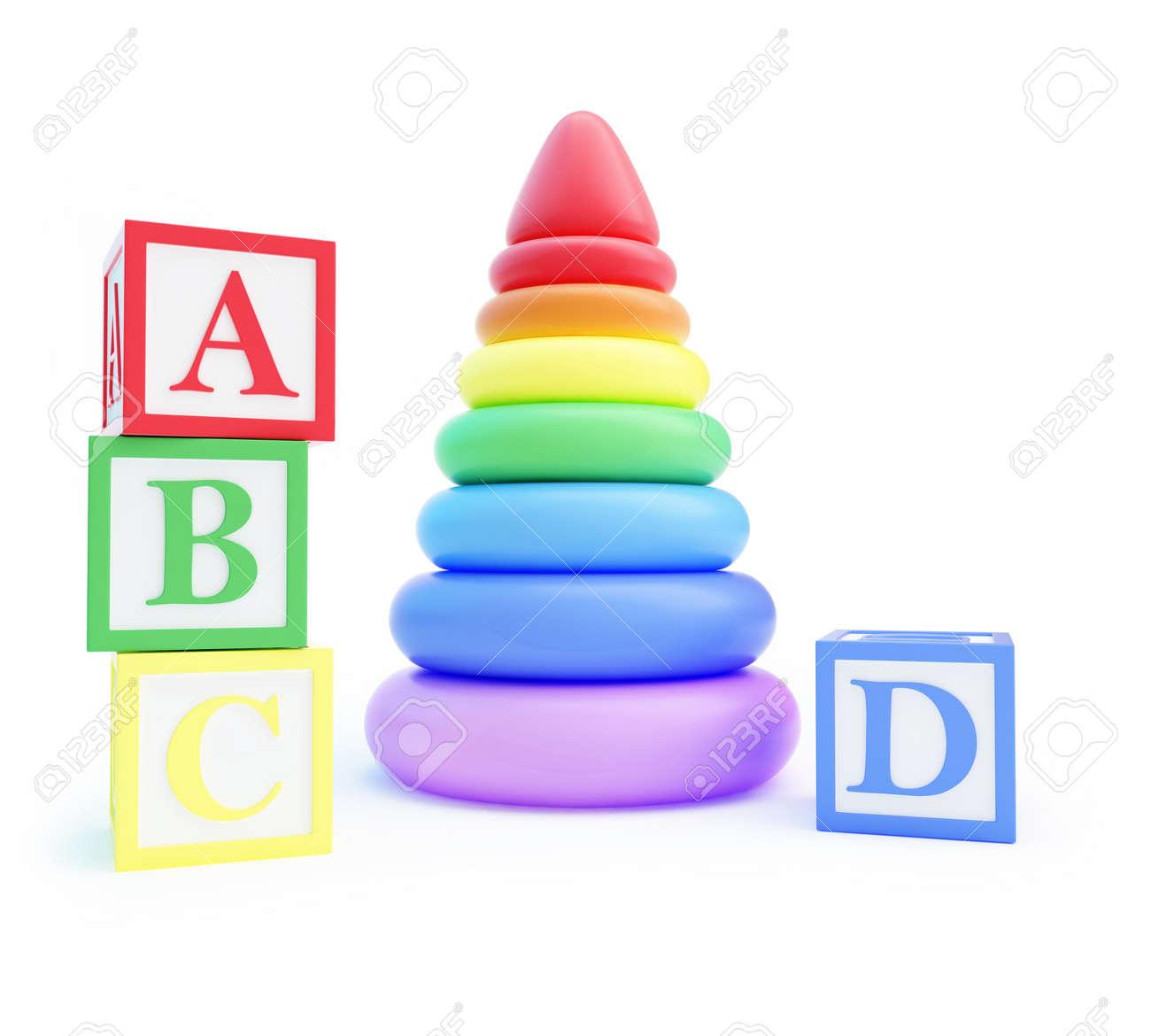 pyramid toy and alphabet blocks on a white background Stock Photo - 17577003