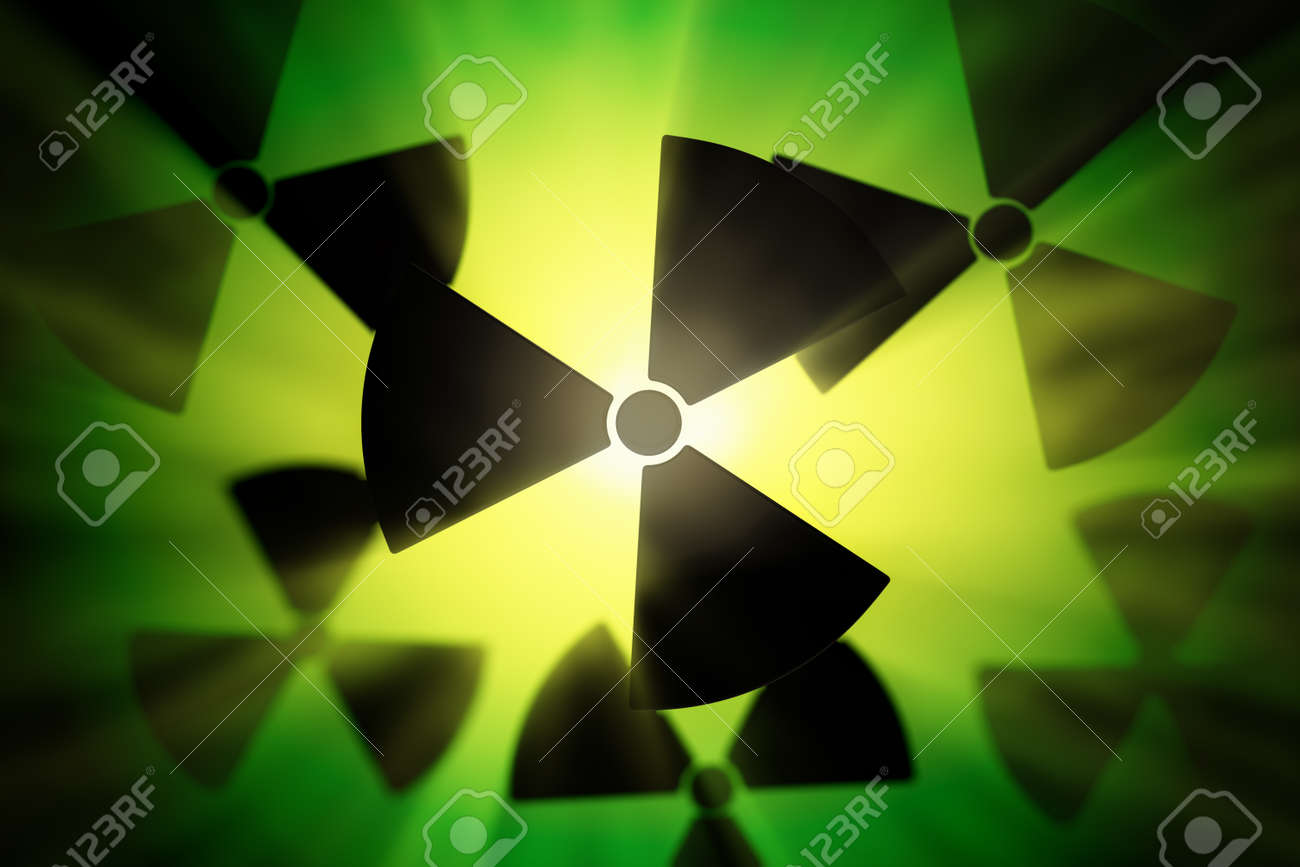 Radioactive danger symbol with a shine green background Stock Photo - 19612459