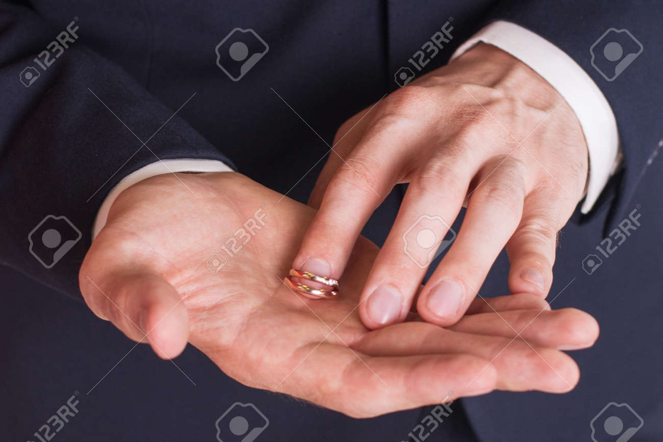 Man Is Taking Off The Wedding Ring. Stock Photo, Picture And Royalty ...